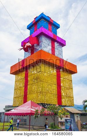 MEDELLIN, COLOMBIA, DECEMBER - 12, 2016 - Multicolored gift tower in the top of Nutibara hill at Pueblito Paisa, a traditional small turistic colonial village in the city of Medellin, Colombia.