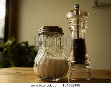 Pepper and Salt in glass on the wooden table