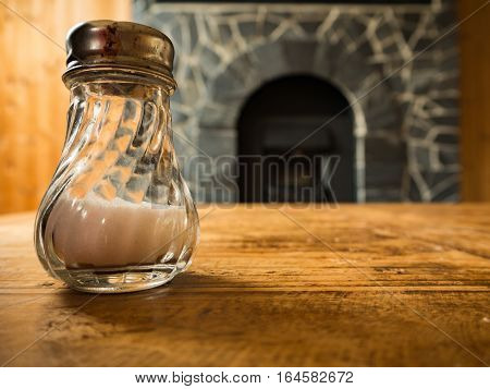 Salt in glass on the wooden table