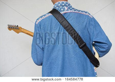 Boy with electric guitar lover Get ready for a great concert happily.