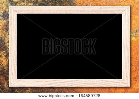 Blackboard or Empty bulletin board with a wooden frame on cement wall background with copy space for text or image.