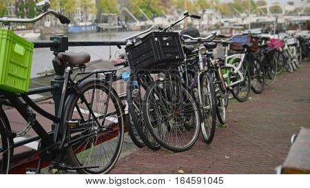 Center of Amsterdam - bicycles parking near amstel canal, the Netherlands, wide angle