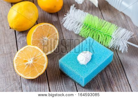 Eco-friendly natural cleaners baking soda lemon and cloth on wooden table Homemade green cleaning