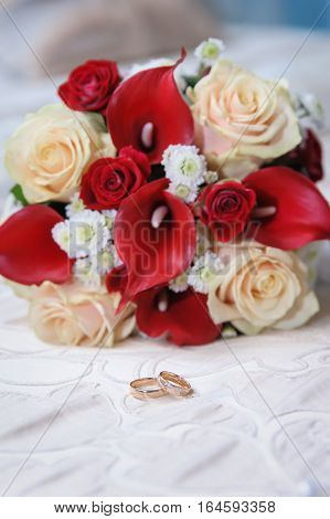 The Wedding concept with roses and rings