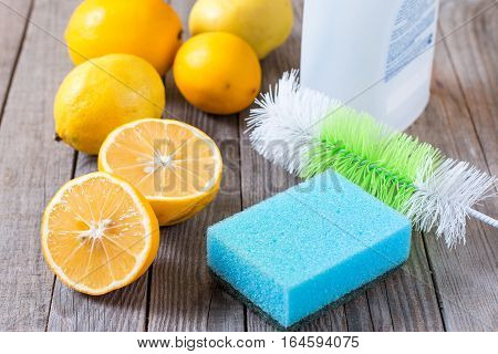 Eco-friendly natural cleaners (lemon and sodium bicarbonate) on wooden table