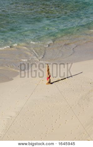 Woman Doing Pilates On A Barbados Beach
