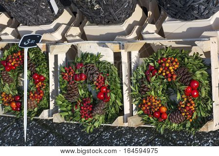 Several new years wreathes with cones and rowan berries in the shop