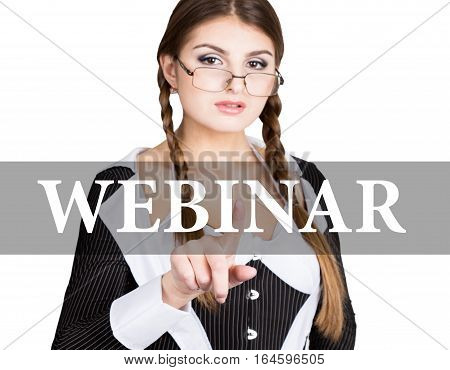 webinar written on virtual screen. sexy secretary in a business suit with glasses, presses button on virtual screens. technology, internet and networking concept