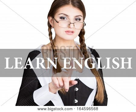 learn english written on virtual screen. sexy secretary in a business suit with glasses, presses button on virtual screens. technology, internet and networking concept