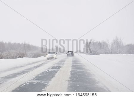 winter road cars on the road snowstorm