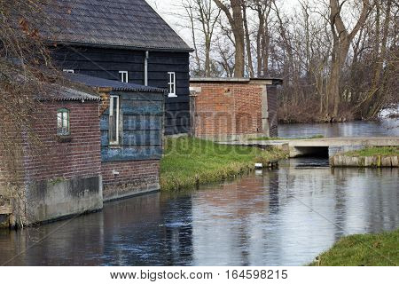 Barn and some old shacks in the Netherlands during winter