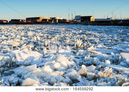 Winter frozen sea with ice blocks and cold weather