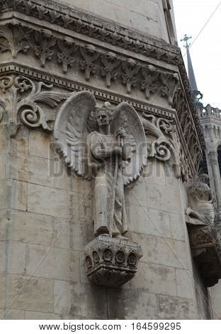 angel with wings. Detail architecture Basilica of Notre-Dame de Fourviere is located on the hill of Fourviere. Lyon. France.