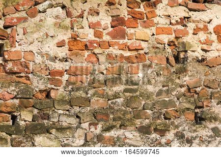 Old damaged brick wall under construction background