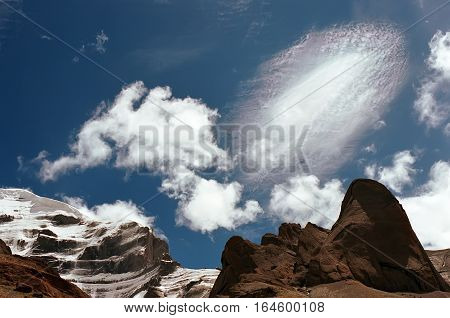 An unusual iridescent cloud at the Western Face of sacred Mount Kailash in Tibet.