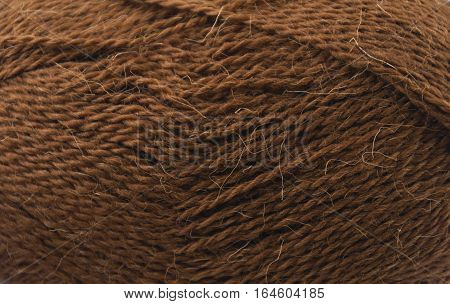 close up of a hank of brown yarn for knitting
