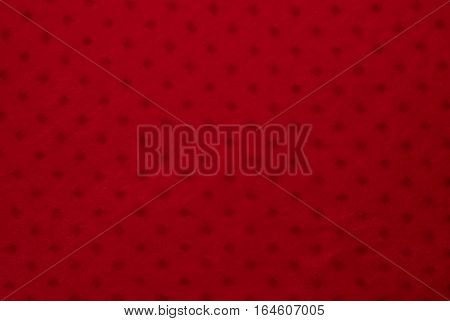 Close up of red colored textile texture for background