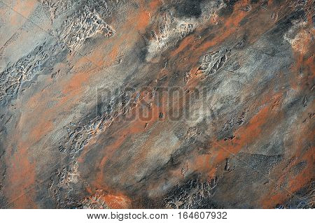 ocher black spotted decorative stucco surface background