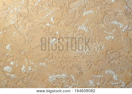 ocher beige color relief plaster and inequality