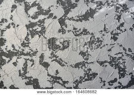 Old dark plaster wall grunge structure. Scratched grey concrete background.