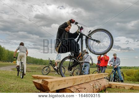 Tyumen, Russia - September 16, 2007: Second festival of cyclists Samogon in Silkin Log. Cyclists jump through a log as a sports stage