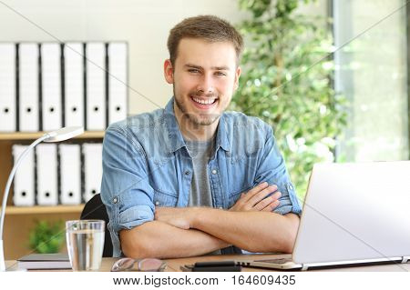 Proud freelance man posing at office and looking at camera