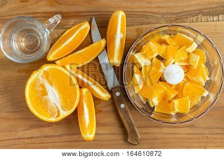 Make orange juice at home. Sliced oranges for fresh orange juice.