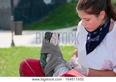 Paramedic Bandaging Ankle
