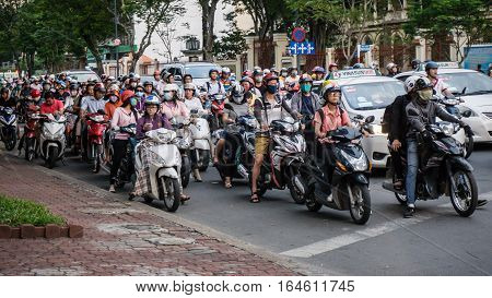 Saigon, Vietnam - November 28, 2015: Road traffic in Saigon, Vietnam. In the biggest city in Southern Vietnam are more than 4 mil. motorbikes, the traffic is often congested