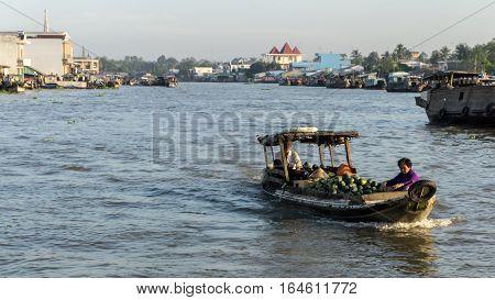 Mekong, Vietnam - November 29, 2015: Vietnam, Mekong river delta. Boat on traditional floating market