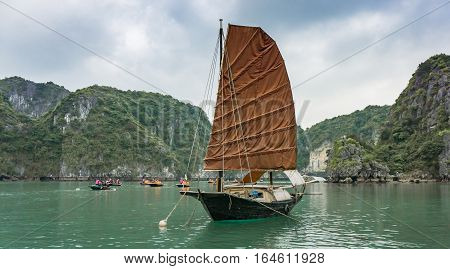 Ha Long Bay, Vietnam - December 02, 2015: Traditional boat at Halong Bay, Vietnam. Unesco World Heritage Site. Most popular place in Vietnam