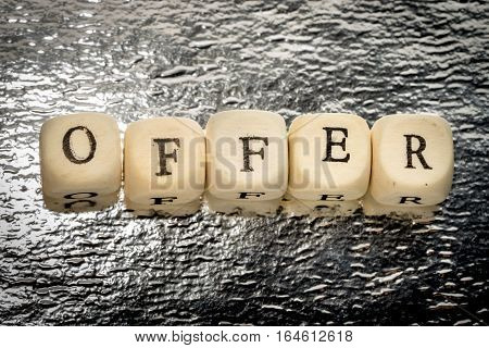 Offer Text On A Wooden Cubes On A Shiny Silver Background