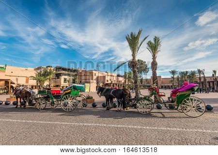 Marrakesh Morocco - December 8 2016: Horse-drawn carriages waiting for tourists in Marrakesh Morocco Africa.