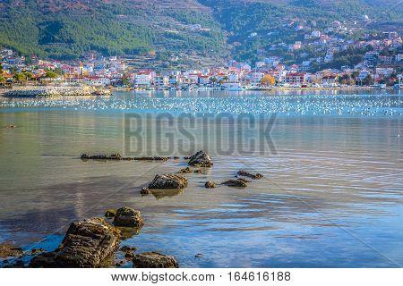 Scenic view at small mediterranean town Podstrana in suburb of town Split, croatian summer touristic destination.