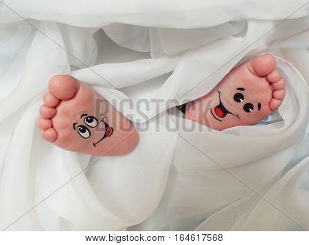 Funny Baby feet wrapped in white cloth