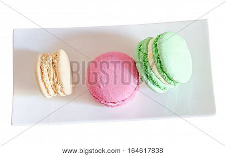 Multi Colored Sweet Macaroons, French Traditional, Cream,  White Plate, Close Up, Isolated On A Whit