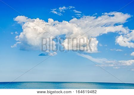 Blue Sky With Fluffy Clouds, Over Clear Sea Water, Outdoor At Noon.