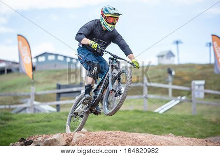Mt Buller, Australia - January 5, 2017: Downhill mountain bike riders attempt the ABOM and International tracks on January 5, 2017 in Mt Buller, Australia