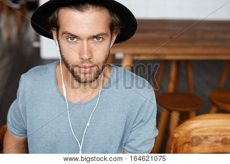People, Leisure And Lifestyle. Indoor Portrait Of Fashionable Young Bearded Student Wearing Stylish