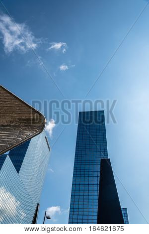 Rottedam The Netherlands - August 6 2016: Modern architecture office building in Rotterdam low angle view. The Gebouw Delftse Poort is a twin-tower skyscraper complex next to the Rotterdam Centraal railway station in Rotterdam.