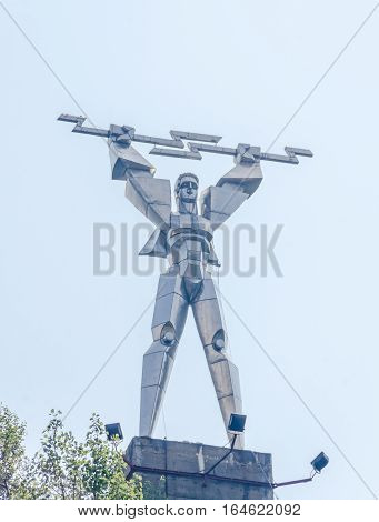 Vidraru, Romania - August 9, 2016: The Statue Of Prometheus (monumentul Electricitatii) Near The Bar