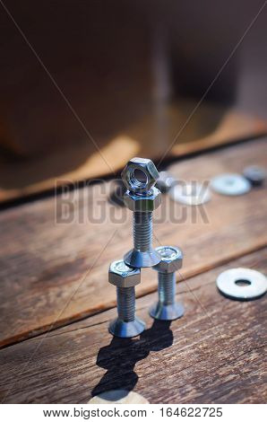 Figure Of Small Robot Assembled From Bolts And Nuts