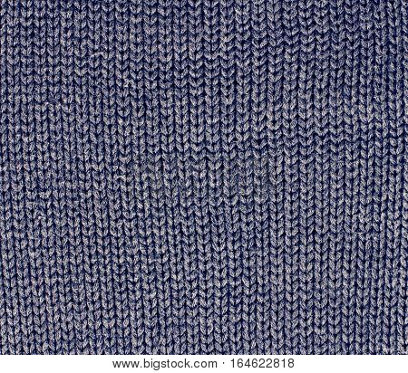Winter Sweater Design. Grey knitting wool texture background. knitted fabric texture. Knitted jersey background with a relief pattern. Braids in knitting