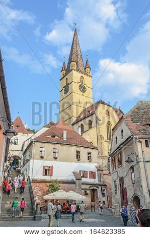 Sibiu, Romania - August 10, 2016: Streets Of The Downtown City With Restaurants And Old Buildings, T
