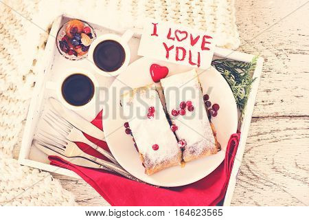 Strudel and coffee on a tray. Breakfast. Breakfast in bed breakfast for Valentine's Day
