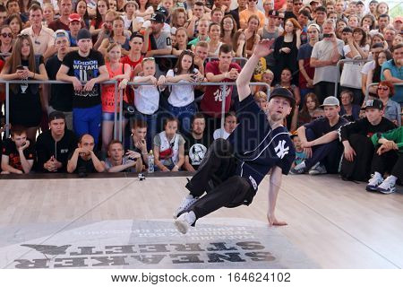 PERM RUSSIA - JUN 12 2016: Young man dances breakdance at Street fight festival on street stage during Day of Russia holiday this is public event