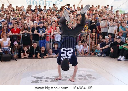PERM RUSSIA - JUN 12 2016: Man dances breakdance at Street fight festival on street stage during Day of Russia holiday this is public event