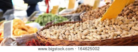 Basket Of Roasted Peanuts For Sale In The Stand Of Dried Fruit