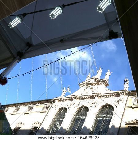 Reflected On A Mirror Of An Ancient Church In The Square Of The