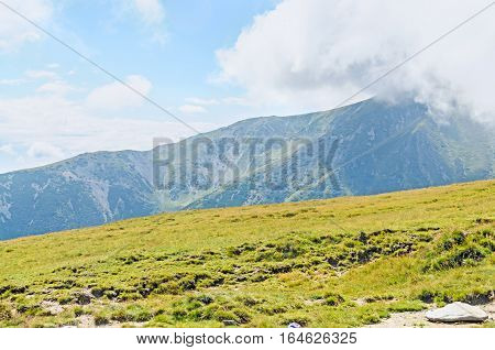 Parang Mountains In The Clouds, Hills With Green Grass And Rocks, Transalpina Road, Carpathian Mount